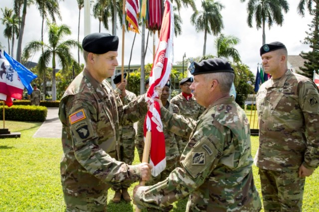 Col. Thomas J. Tickner (left) receives the Army Colors from Lt. Gen. Todd T. Semonite, Chief of Engineers and Commanding General of the U.S. Army Corps of Engineers in a Change-of-Command ceremony, July 27, at Fort Shafter, Hawaii.   Brig. Gen. Peter B. Andrysiak (right) relinquished command of the USACE-POD to Tickner, who became the 33rd commander of the division.