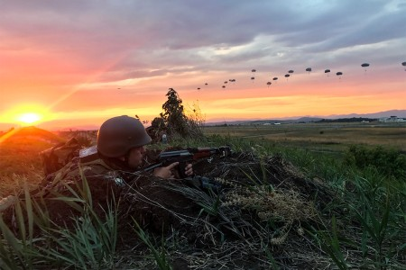 Bulgarian Soldier pulls security on a bunker as paratroopers from the 173rd Airborne Brigade, descend onto Bezmer Air Base, Bulgaria, July 18, 2017.