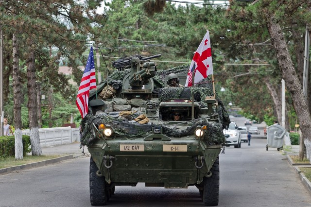 Strykers from 2nd Cavalry Regiment arrive in Khashuri, Georgia, July 31, 2017, to greet local residents as they begin Noble Partner. Noble Partner 17 is a European Rotational Force exercise of Georgia's light infantry company contribution to the NATO Response Force. The exercise provides participating nations with the opportunity to train in a multinational environment while enhancing cooperation and interoperability during realistic and challenging training events.