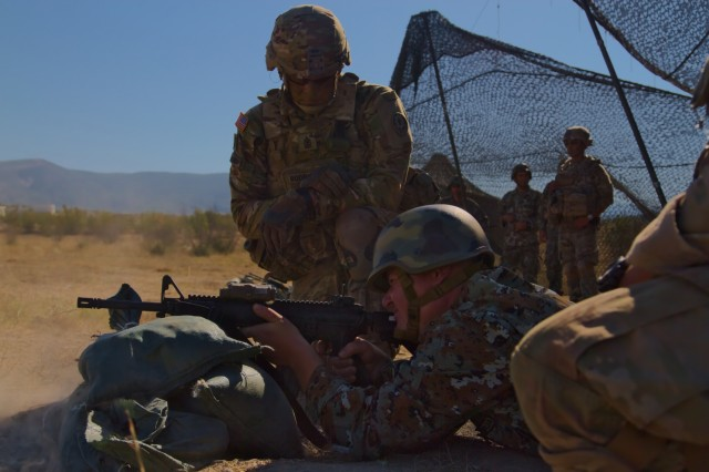 U.S. Army 1st Sgt. Roy Rodriguez, first sergeant of Troop A, Regimental Engineering Squadron, 2nd Cavalry Regiment, guides Macedonian Pvt. Ivica Petrov, a soldier with 1st Platoon, Engineering Battalion, on firing an M4 rifle during a firing range at Krivolak Training Area, Macedonia on August 1, 2017. The Regimental Engineering Squadron is currently working in country as a part of Dragoon Guardian, an offshoot of Operation Atlantic Resolve, a NATO mission involving the U.S. and Allied and partnered nations in Europe, designed to promote peace and deter aggression across the region. (Photo by Army Pfc. Nicholas Vidro, 7th Mobile Public Affairs Detachment)