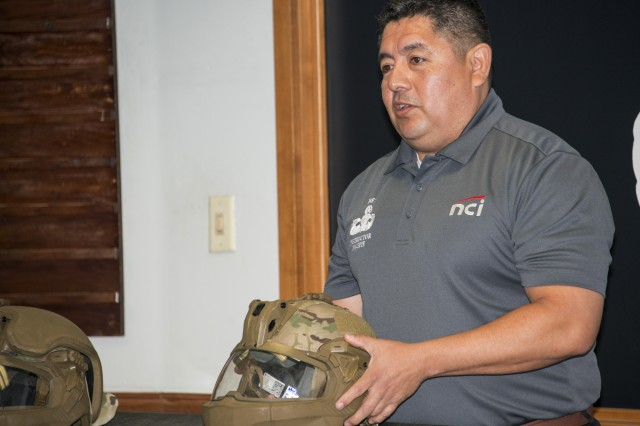 Bobby Salazar, from Program Manager Soldier Protection and Individual Equipment, out of Fort Belvoir, Virginia, discusses proper fitting of the new Integrated Head Protection System (IHPS) during New Equipment Training.