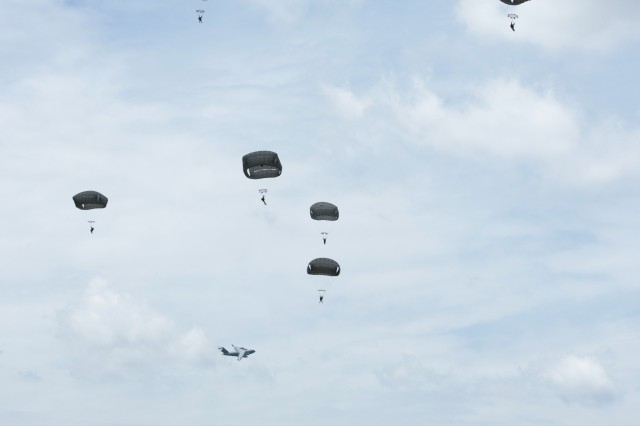 Soldiers from the 57th Sapper Company, 27th Engineer Battalion, 20th Engineer Brigade, descend under the T-11 parachute over Sicily Drop Zone, Fort Bragg, North Carolina, while performing an operational test of the new Integrated Head Protection System (IHPS).