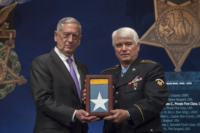 Secretary of Defense Jim Mattis presents Spc. 5 James C. McCloughan the Medal of Honor flag during McCloughan's Medal of Honor Hall of Heroes induction ceremony Aug. 1, 2017, at the Pentagon in Washington, D.C. McCloughan distinguished himself during 48 hours of close-combat fighting against enemy forces May 13 to 15, 1969. At the time, then-Pfc. McCloughan was serving as a combat medic with Company C, 3rd Battalion, 21st Infantry, 196th Light Infantry Brigade, Americal Division, in the Republic of Vietnam.
