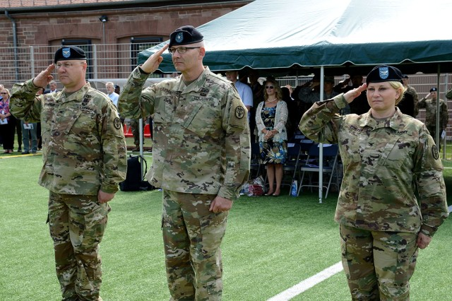 Left to Right, Col. Steven Greiner, Public Health Command Europe outgoing commander; Brig. Gen. Dennis LeMaster, Regional Health Command Europe commanding general; and Col. Rebecca Porter, incoming PHCE commander, salute during the PHCE change of command ceremony July 31 at Kirchberg Kaserne, Germany.