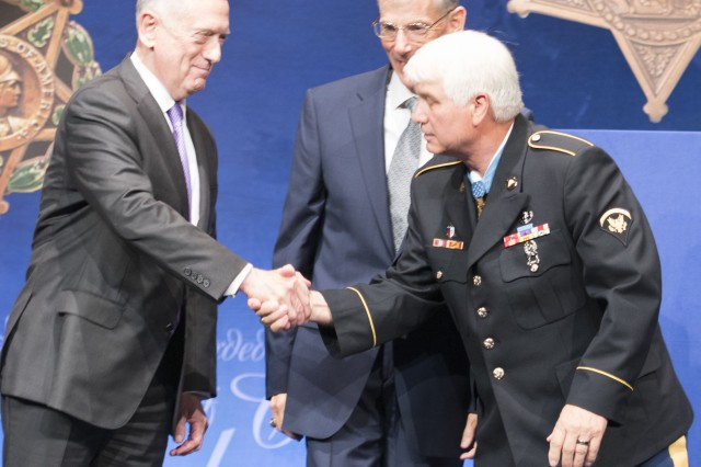 "Hall of Heroes inductee James ""Doc"" McCloughan shakes hands with Defense Secretary James Mattis during a ceremony Tuesday at the Pentagon."