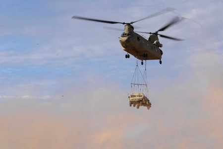 CH-47 Chinook transports a HUMVEE during a sling load operation as part of the Network Integration Evaluation (NIE) 17.2 at Fort Bliss, Texas, July 24, 2017.