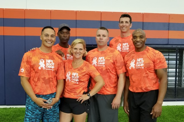 From left, Sgt. 1st Class Christian Budeshefsky, Command Sgt. Maj. David Williams, Maj. Michelle Kelly, Sgt. 1st Class Brian Picklesimer, Capt. Nathaniel Hoekje, and Capt. Derrick Williams, pose for a picture before competing in the Broncos and USAA NFL Boot Camp challenge July 31 at the Broncos training camp in Englewood, Colorado.