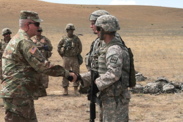VAZIANI TRAINING BASE, Georgia - Cpl. Andrew Fregine, team leader, 2nd platoon, 810th Engineer Company (SAPPER), 878th Engineer Battalion, 648th Maneuver Enhancement Brigade, Georgia Army National Guard, based in Swainsboro, Georgia, receives a coin from Brig. Gen. Thomas Blackstock Jr., Commander, 78th Troop Command, Georgia National Guard, at Vaziani Training Base, Georgia, Aug. 2, 2017. His solid performance in the advance party leading up to Noble Partner made him a clear choice for the company commander. The unit is currently in the country Georgia to participate in Exercise Noble Partner. Exercise Noble Partner is a multinational, U.S. Army Europe-led exercise conducting home station training for the Georgian light infantry company designated for the NATO Response Force. (U.S. Army photo by Sgt. Shiloh Capers)