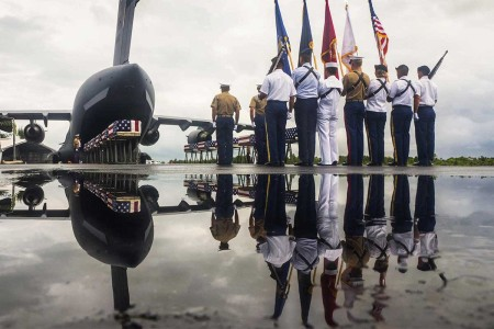 Members of the Defense POW/MIA Accounting Agency conclude a repatriation ceremony for service members missing from the battle of Tarawa, Republic of Kiribati, July 25, 2017. The remains of at least 17 service members were excavated by History Flight Inc., a strategic partner with DPAA. The mission of DPAA is to provide the fullest possible accounting for our missing personnel to their families and the nation.