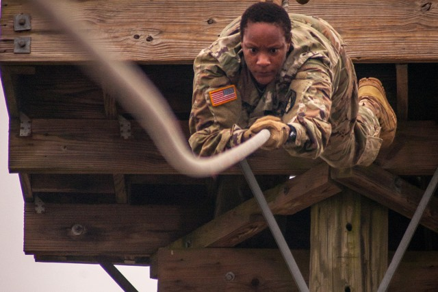 Staff Sgt. Tamara Burns, drill sergeant with Company B, 2nd Battalion, 48th Infantry Regiment, makes her way down the slide- for-life obstacle on the confidence course. Burns, and 27 other drill sergeants, ran the course in preparation to pick up trainees.
