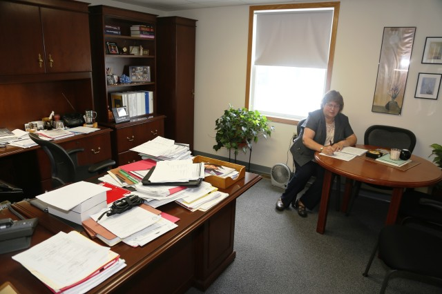 Mary Purpus takes notes while participating in a conference call July 26, 2017, in her office at Fort McCoy, Wisconsin. Purpus and her staff provide support to the installation and its tenants as well as the 88th Regional Support Command with geographic locations in a 19-state region. Purpus is the director of the Mission and Installation Contracting Command-Fort McCoy contracting office.