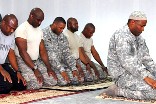 Muslim Chaplain Lt. Col. Ibraheem Raheem, a chaplain for more than 18 years,  can't count the number of people he has served in his profession. He only wishes he could have served more.  Above, he leads a prayer service.