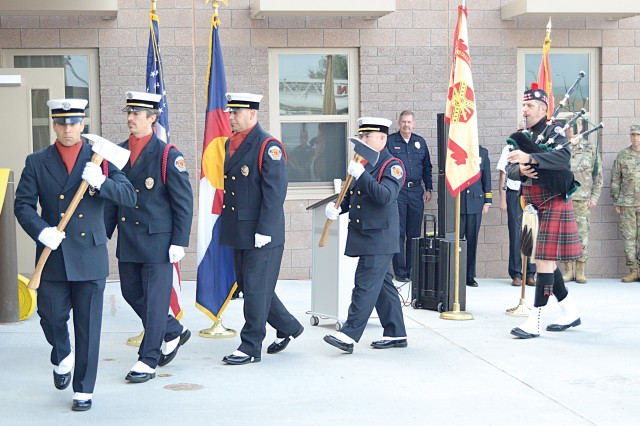 FORT CARSON, Colorado -- A Fort Carson Fire Department honor guard posts colors during a grand opening ceremony for Fire Station 33 at Butts Army Airfield July 28, 2017.