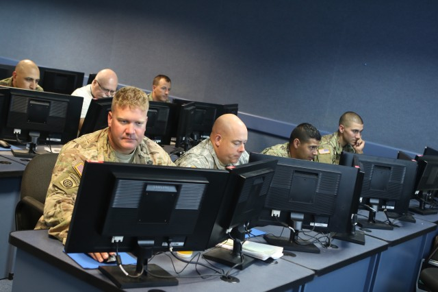 Students work through training on the Digital Image Exploitation Engine program at Fort Sill, Okla. The Army Targeting Center staff and instructors from the 428th Field Artillery Brigade certified the students, a mixed group of active-duty, Reserve, National Guard, NGA employees and instructors from other services. The first class graduated July 21, 2017.