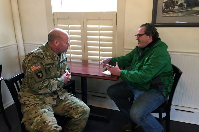 To help promote the Arsenal's hiring actions, Arsenal Commander Col. Joseph Morrow is explaining to Times Union reporter Larry Rulison during the January 2017 job fair about the job opportunities that were available here.