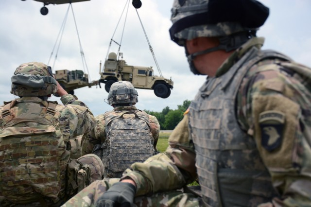 Soldiers from the 2nd Brigade Combat Team, 101st Airborne Division (Air Assault) watch as a CH-47 Chinook flown by Soldiers from the 101st Combat Aviation Brigade, 101st Airborne, sling loads the Tactical Control Node-Lite at Fort Campbell, Kentucky, Jun. 15, 2017.