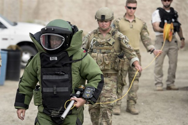 Detective Jack Blanchard of Los Angeles Police Department bomb squad, front, leads a combined military and police explosive ordnance disposal team during the Raven's Challenge explosive ordnance disposal exercise at Camp Pendleton, California, Aug. 2, 2017. With him are Air Force Staff Sgt. Robert Powell, Air Force Senior Airman Jared Basham, and Al Carbonara, LAPD bomb squad.