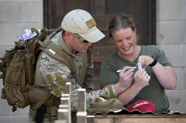 Air Force Staff Sgt. Cole Carroll, left, updates a hand-drawn map to a bomb with Belgian army 1st Sgt. Maj. Nele Van Keer during the Raven's Challenge explosive ordnance disposal exercise at Camp Pendleton, California, Aug. 1, 2017.