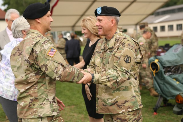 Brig. Gen. Steven Ainsworth, right, shakes hands with Command Sgt. Maj. Raymond Brown middle, after the 7th Mission Support Command change of command ceremony Aug. 4, 2017 on Daenner Kaserne in Kaiserslautern, Germany. Ainsworth turned command over to Brig. Gen. Frederick R. Maiocco Jr. during the ceremony.