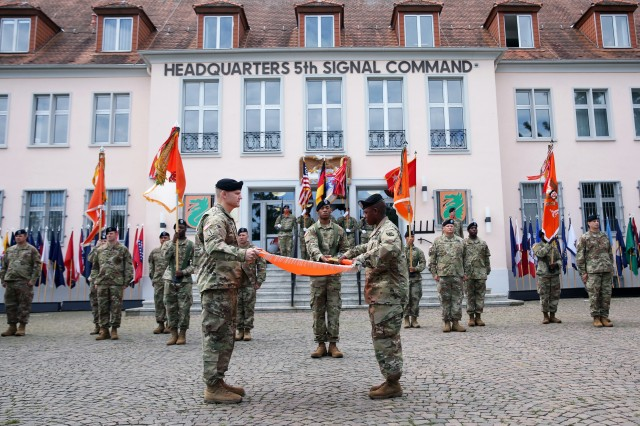 U.S. Army Col. Rob Parker, the U.S. Army Europe chief information officer/G-6 and last commander of 5th Signal Command (Theater), and Command Sgt. Maj. Gregory Rowland, 2nd Theater Signal Brigade senior enlisted leader, case the 5th Signal Command's colors at an inactivation ceremony Aug. 4, 2017, at Clay Kaserne in Wiesbaden, Germany.
