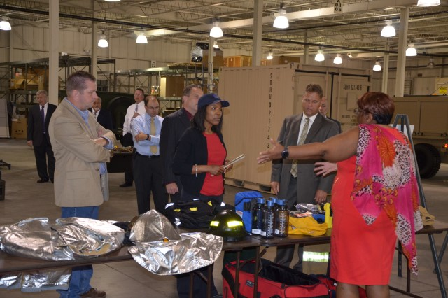 Easter learns more about how PEO CS&CSS' Project Management Office for Force Projection manages approximately 20 percent of the Assistant Secretary of the Army for Acquisition, Logistics and Technology's entire equipment portfolio.  Here, she checks out Army firefighting equipment under the Product Management Office for Sets, Kits, Outfits and Tools' purview.
