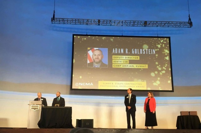 An Army civilian assigned to U.S. Army Contracting Command has earned the 2017 Elmer B. Staats Contracting Professional Excellence award.   Adam Goldstein, 408th Contracting Support Brigade, civilian deputy, Camp Arifjan, Kuwait, received the award, on July 26, during the National Contract Management Association World Congress at the Navy Pier in Chicago. The Staats award recognized his significant contributions to contracting operations and acquisition policy.