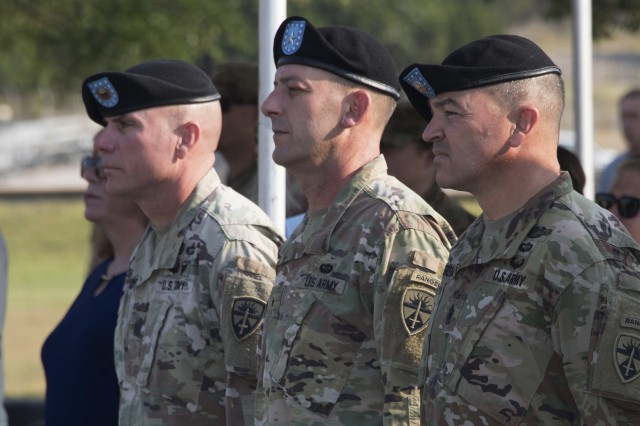 Command Sgt. Maj. Jason Schmidt (far left), outgoing senior enlisted leader of the U.S. Army Operational Test Command, stands alongside OTC Commanding General Brig. John C. Ulrich (center), and incoming OTC Command Sgt. Maj. Mario O. Terenas (right), during OTC's senior enlisted leader change of responsibility ceremony Friday.