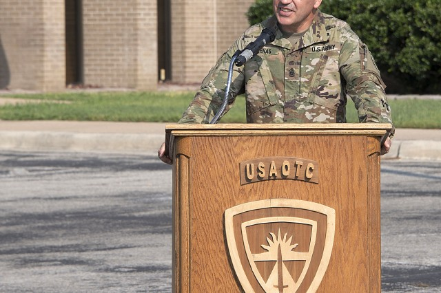 Incoming U.S. Army Operational Test Command Command Sgt. Maj. Mario O. Terenas speaks from the podium as the unit's new standard bearer during OTC's senior enlisted leader change of responsibility ceremony Friday.