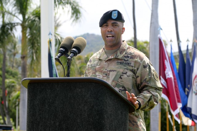 """Brig. Gen. Ronald P. Clark, incoming USARPAC Chief of Staff, speaks to Soldiers and Family during a Flying """"V"""" ceremony Aug. 2 at Palm Circle on Fort Shafter. Clark was welcomed to USARPAC during the ceremony, which formally welcomes incoming or honors outgoing senior Army officials to USARPAC. The """"V"""" refers to the way the colors are posted during the ceremony, which is V-shaped. (U.S. Army photo by Staff Sgt. Justin Silvers, U.S. Army Pacific Public Affairs)"""