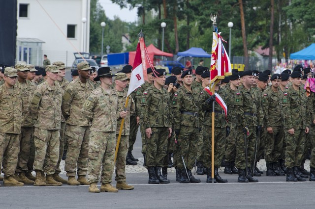Capt. William Partin, Commander of Troop B, 4th Squadron. 10th Cavalry Regiment and his Troop stand shoulder-to-shoulder with the Polish 10th Armored Cavalry Brigade Soldiers during the 73rd commemoration ceremony August 4th, 2017, at the Garrison Square in Swietoszow, Poland. The 4th Sqdn., 10th Cav. Regt., is on a nine-month deployment, rotating through the European theater in support of Operation Atlantic Resolve. This U.S. led effort in Eastern Europe demonstrates the U.S. commitment to strengthening the defensive and deterrent capabilities of the NATO Alliance while improving the professional relationship.