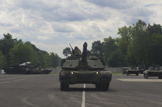 U.S. M1 Abrams tank participates in the dynamic vehicle display during the 73rd commemoration ceremony August 4th, 2017, at the Garrison Square in Swietoszow, Poland. The 4th Squadron, 10th Cavalry Regiment, is on a nine-month deployment, rotating through the European theater in support of Operation Atlantic Resolve. This U.S. led effort in Eastern Europe demonstrates the U.S. commitment to strengthening the defensive and deterrent capabilities of the NATO Alliance while improving the professional relationship.