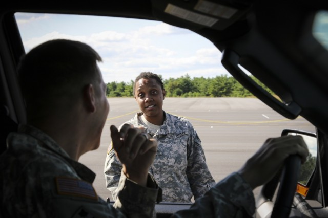 Army Reserve Sgt. Teaca Jackson, a military police Soldier and native of Queens, New York, assigned to the 335th Signal Command (Theater), discusses driving techniques with Sgt. Karl S. Hart, a military police Soldier and security driver, assigned to the 335th SC (T), during a challenging Emergency Vehicle Operators Course at Joint Base McGuire-Dix-Lakehurst, New Jersey, Aug. 5. A group of eight Soldiers from the 335th SC (T), spent two days acquiring and honing their emergency vehicle driving skills in the course.