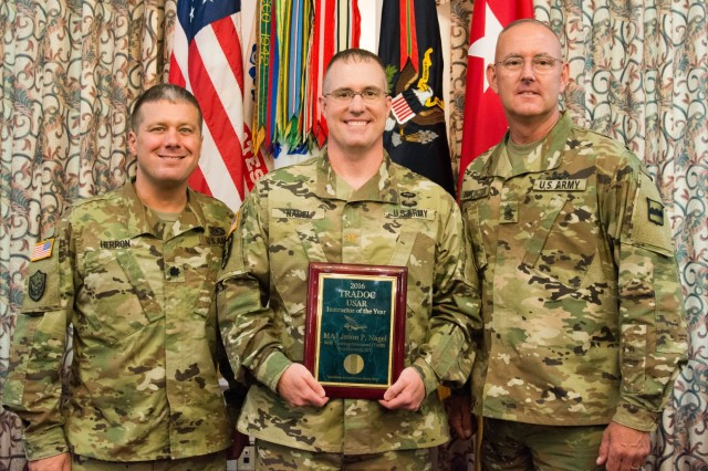(Left to right) Lt. Col. Ricky Herron, commander of the 11th Battalion, 95th Regiment, 97th Training Brigade, 100th Training Division, 80th Training Command; Maj. Jason Nagel; and Command Sgt. Maj. Jeffrey Darlington, the senior enlisted leader for the 80th TC, pose for photographs at the Training and Doctrine Command 2016 Instructor of the Year Awards ceremony at Fort Eustis, Virginia, Aug. 3, 2017. Nagel won the award in the Army Reserve category. He is assigned to the 11th Battalion.