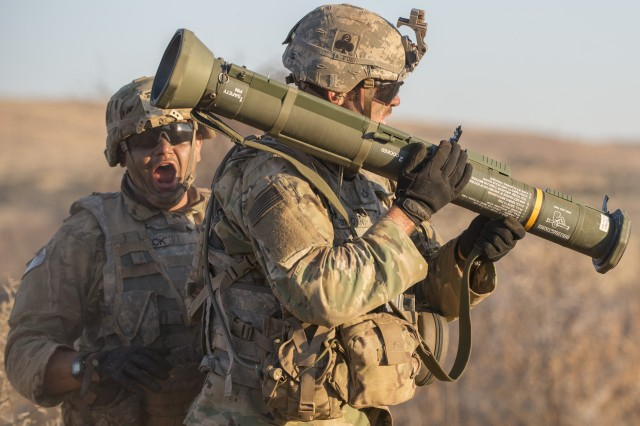 Sgt. Erik Yazbeck, left, yells for others to keep their distance as Pfc. Andrew Brown prepares to fire an AT-4 rocket launcher during live-fire training for the Shared Accord exercise at the South African Army Combat Training Center in Lohatla July 30, 2017. The two-week exercise, which ended Aug. 3, allowed Brown and other Soldiers from 101st Airborne Division's 2nd Battalion, 327th Infantry Regiment to hone their skills on anti-armor weapons.
