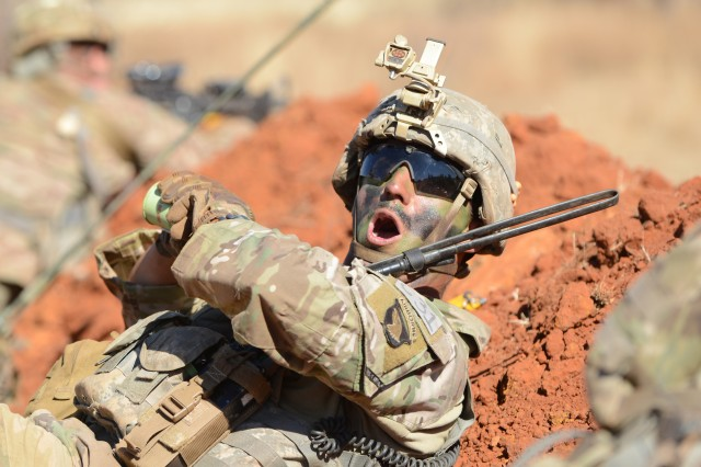 Staff Sgt. Donovan Sweet, a squad leader, prepares to throw a smoke grenade over a small berm before his squad attacks an objective during combined arms maneuver training, as part of the Shared Accord exercise at the South African Army Combat Training Center in Lohatla July 30, 2017. The two-week exercise, which ended Aug. 3, allowed Soldiers from 101st Airborne Division's 2nd Battalion, 327th Infantry Regiment to hone their skills on anti-armor weapons and maneuver tactics.