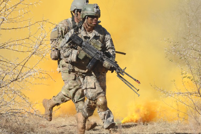 A pair of Soldiers with 101st Airborne Division's 2nd Battalion, 327th Infantry Regiment run through a smoke screen during combined arms maneuver training, as part of the Shared Accord exercise at the South African Army Combat Training Center in Lohatla July 30, 2017. The two-week exercise, which ended Aug. 3, allowed Soldiers to hone their skills on anti-armor weapons and maneuver tactics in a foreign country.