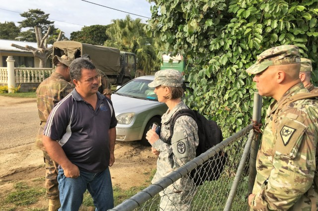 Maj. Kimberly Yore (center), an Army veterinarian from Joint Base Lewis-McChord in Washington state, interviews a village elder about the health treatment of local animals escorted by Lt. Col. Randy Lau (right), the Nevada National Guard State Partnership Program director, in the Kingdom of Tonga, July 17, 2017.