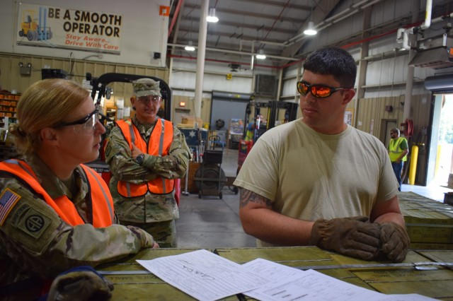 Commander of Joint Munitions Command Col. Heidi Hoyle, accompanied by Command Sgt. Maj. Tomeka O'Neal, visited Crane Army Ammunition Activity and was given a brief overview of CAAA's capabilities August 3. While touring a shipping and receiving facility, O'Neal had the opportunity to speak with CAAA employees about the logistical components of Crane Army's depot operations mission. (Photo by Hayley Smith, Crane Army Public Affairs)