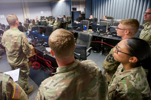 Soldiers provide an Intelligence Preparation of the Battlefield brief to their classmates at Joint Base Lewis-McChord Aug 3.  The Soldiers are participating in the  Military Intelligence Skills Enhancement Program (MISEP) Apprentice Certification Course.