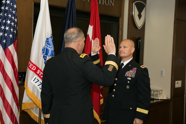U.S. Army Gen. Gus Perna, Army Materiel Command commanding general, conducts the oath of office with Lt. Gen. Edward Daly during a promotion ceremony at the AMC Headquarters at  Redstone Arsenal, Alabama, Aug. 7, 2017. Daly assumed duties as AMC's deputy commanding general and Redstone Arsenal senior commander. Daly will be responsible for the day to day operations of AMC. (U.S. Army photo by Sgt. 1st Class Teddy Wade)