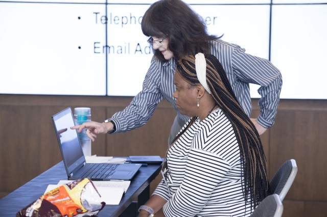 "Pauline Higgins reviews Linda Perry's resume during a ""Resume Writing"" class July 27 at the U.S. Army Security Assistance Command."