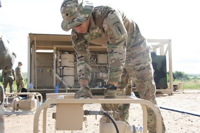 A soldier with the Sustainment and Distribution Company, 10th Special Forces Group (Airborne), operates the Tactical Water Purification System as part of their water purification training at a reservoir on Fort Carson, Colo. July 27, 2017. (US Army Photo by Sgt. Brandon Franklin)
