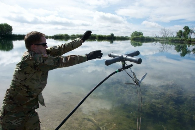 Sgt. William Sedberry, a water treatment specialist assigned to 10th Special Forces Group (Airborne), tosses the suction head portion of an Aspen 5500M Water Treatment System into a Fort Carson, Colo. reservoir in order to begin water purification training July 27, 2017. The Aspen water treatment equipment is small and mobile, which assists special operations forces in sustainment across a wide multitude of environmental conditions. (US Army photo by Sgt. Brandon Franklin)