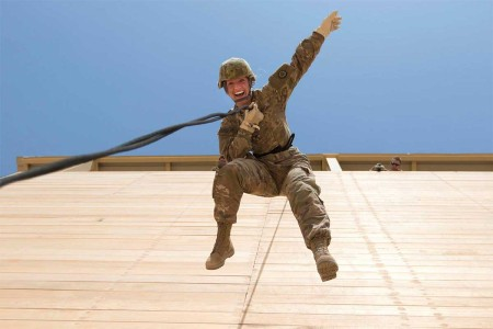 A U.S. Army Reserve Soldier with the 316th Sustainment Command (Expeditionary), based out of Coraopolis, Pa., currently deployed to the U.S. Central Command, rappels off of a tower during a professional development training at Camp Buehring, Kuwait, July 31, 2017.