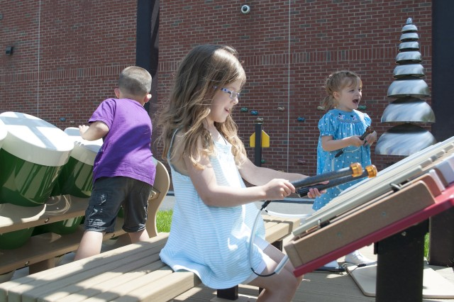 From left, Pre-K students Aiden Wiedyk, Quinn Kish and Juliette Conlkin investigate a music station during outdoor play at Memorial Child Development Center. Pre-K students at Fort Drum receive three hours of formal instruction per day, and have opportunities to engage in a variety of self-led learning opportunities throughout the remainder of their day.