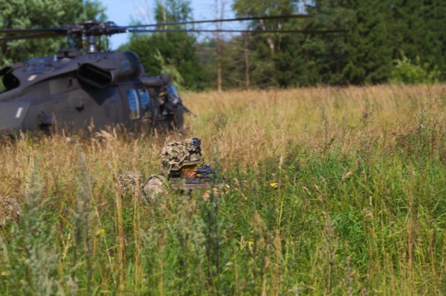 A British Army soldier with the 5th Battalion, The Rifles, 20th Armored Brigade, pulls security in front of a UH-60L Black Hawk during a training exercise at Saase, Estonia on August 9, 2017. The 5th Battalion, The Rifles, 20th Armored Brigade is currently working in Estonia as a part of Operation Atlantic Resolve, which is a NATO mission involving the US and Allied and partnered nations in Europe in an effort to enhance regional stability and to deter aggression.