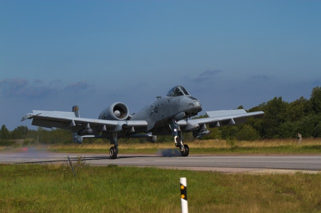 "A US Army A-10 Thunderbolt II ""Warthog"" belonging to the 175th Wing, Maryland Air National Guard, lands on a stretch of highway during an exercise near Jagala, Estonia on August 10, 2017. The exercise was a chance for the public to see NATO forces working together as a part of Operation Atlantic Resolve, which is a NATO mission involving the US and Europe in a combined effort to strengthen bonds of friendship and to promote peace."