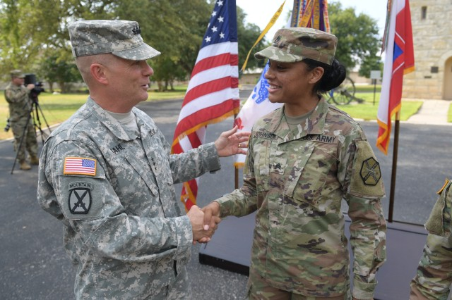 Lt. Gen. Kenneth Dahl, Commander of U.S. Army Installation Management Command, congratulates Sgt. Kayanna Johnson of Fort Gordon, Ga., for her resilient performance in the 2017 Joint Base San Antonio Best Warrior Competition on Aug. 3 at the Fort Sam Houston Quadrangle.