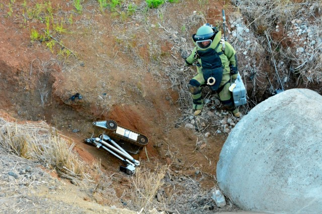 Staff Sgt. Joel Vaccaro, an Explosive Ordnance Disposal Technician from 716th Ordnance Company (Explosive Ordnance Disposal), climbs down a culvert to examine an improvised explosive device during a 2017 United States Army Pacific Command Team of the Year Competition at Schofield Barracks, Hawaii, July 29.