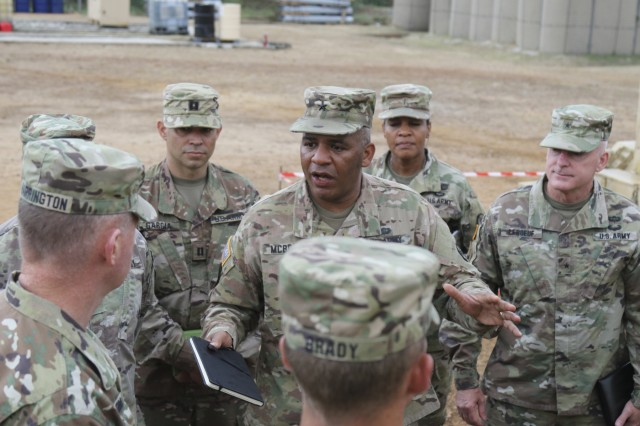 Brig. Gen. Douglas McBride, center, commanding general of the 13th Expeditionary Sustainment Command, briefs Maj. Gen. Joseph P. Harrington, left, U.S. Army Africa commander, and Brig. Gen. Eugene J. LeBoeuf, right, U.S. Army Africa deputy commander, on July 29, 2017, on the work his troops have been conducting during Exercise Judicious Activation 17-2 in Libreville, Gabon. Judicious Activation is a U.S. Africa Command exercise, executed by U.S. Army Africa this cycle, focused on increasing contingency response force capacity to support stability operations on the African continent. (Photo by Sgt. 1st Class Alexandra Hays, 79th Sustainment Command (Support).